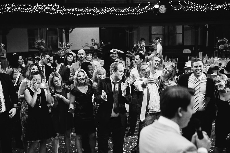guests watching groom sing