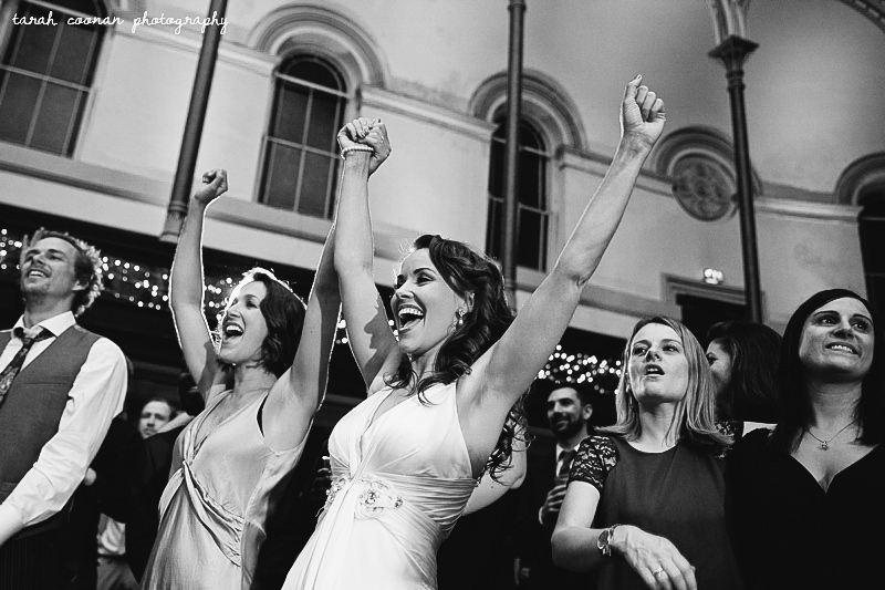 bride and bridesmaid singing