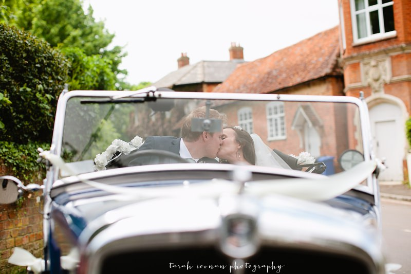 vintage wedding car kiss