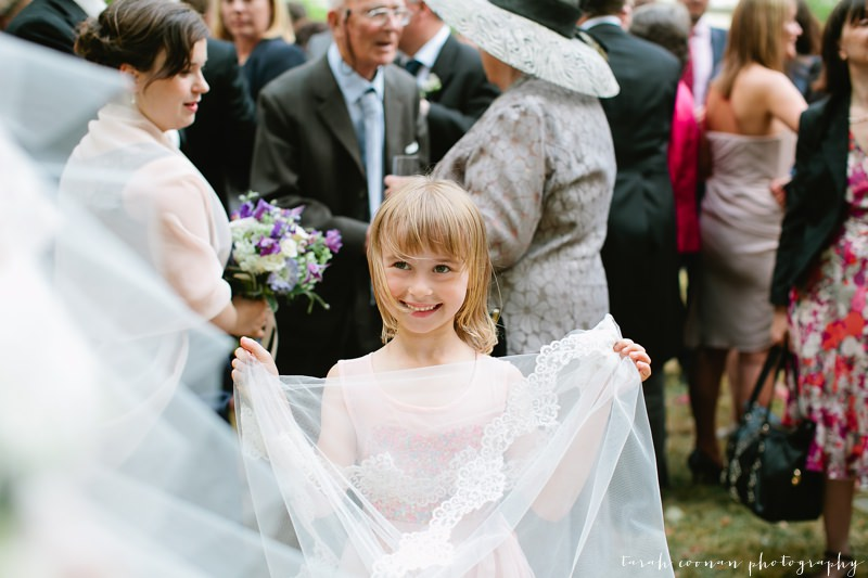 flower girl holding wedding dress