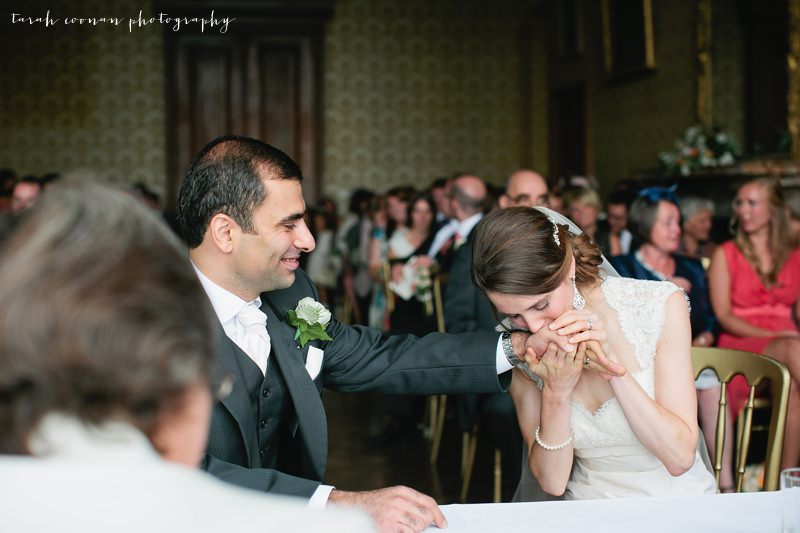 bride kissing grooms hand