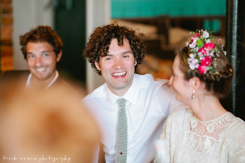 curly haired groom